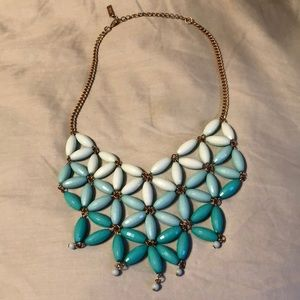 Ombré teal and gold colored fashion necklace.